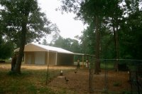 30x30x10, 10\' extended roof line 20\' lean-to. Saddle tan walls, white roof and trim.