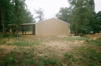30x30x10, 10' extended roof line 20' lean-to. Saddle tan walls, white roof and trim.