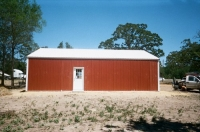 30x40x10 rustic red walls, white trim and roof