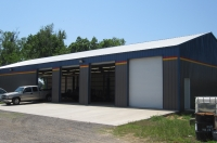 40x100x14, charcoal grey walls, gallery blue trim, white roof